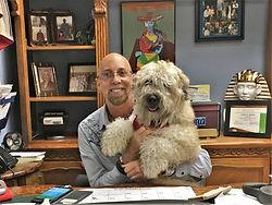 Curtis Allen Designs' Interior Designer Jeffery Spector and his Soft-Coated Wheaton Terrier, Cody.