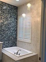 Modern Transitional Bathroom Design with Jellyfish Pendant Lighting, Custom Decorative Wall Tile, Jacuzzi, Plantation Shutters, Custom Cabinetry with Quartz, Fossil Tile
