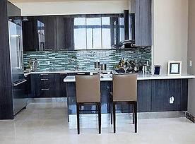 Marble Flooring, Glass Backsplash, Cobalt Cabinetry, Modern Contemporary Kitchen Design, Leather Bar Chairs, Quartz Countertop with Bar Seating