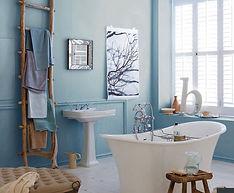 Serene Blue Bathroom with Soak Tub, Personal Art, Pedestal Sink, Plantation Shutters