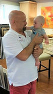 Curtis Wheeler, Owner of Curtis Allen Designs; holding Grandson Logan during a visit by family in Curtis Allen Designs Showroom & Design Center