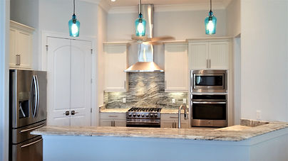 Glass Pendant Lighting, Stainless Appliances, Stainless Hood Vent, Granite Countertop & Backsplash, Crown Molding
