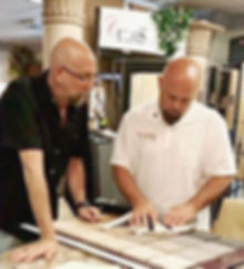 Jeffery Spector and Curt Wheeler working together to choose color and material selections for a project at Curtis Allen Designs' studio and showroom.
