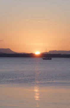 spiritual meaning of depression, sunset, boat