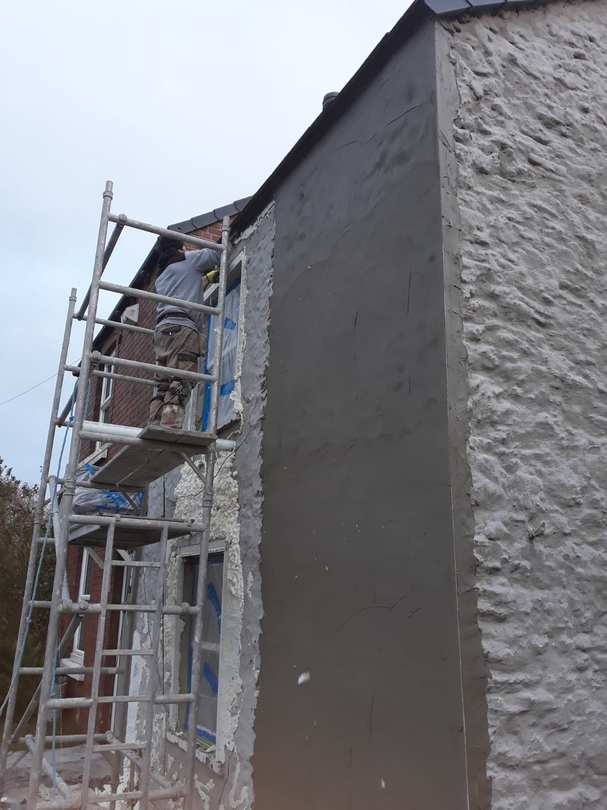 Render Application Prior To Coloured Wall Coating