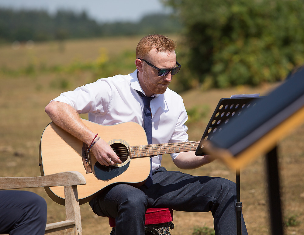 Guitarist at a wedding ceremony. Image courtesy of Ann Aveyard photography