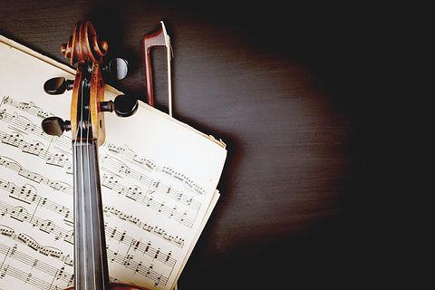 Violin%20over%20Sheet%20Music_edited.jpg
