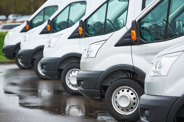 transporting service company. commercial delivery vans in row .jpg