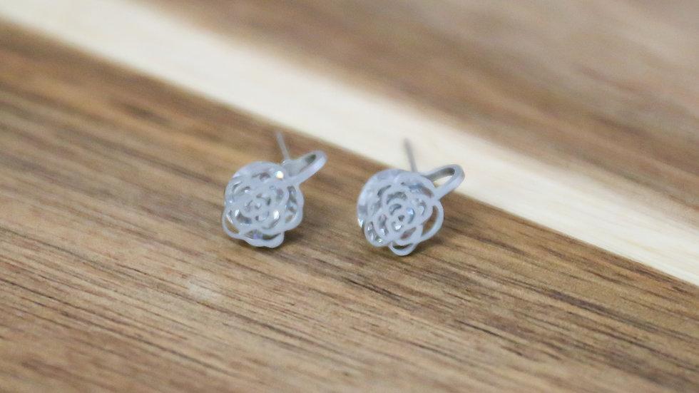 Boucles d'oreilles roses et pierres
