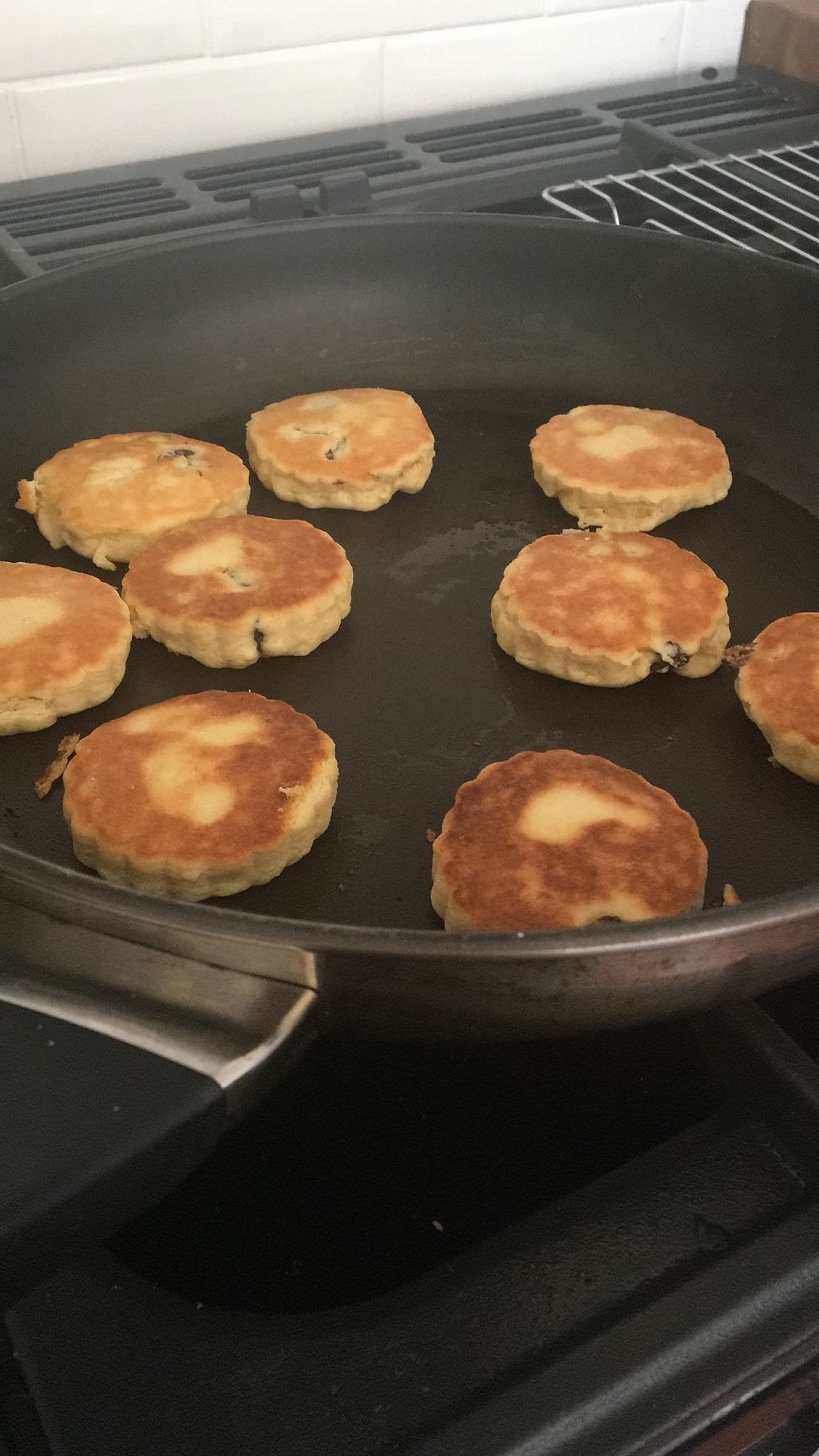 Welsh cakes cooking in the pan
