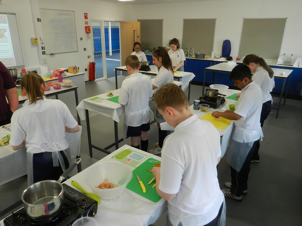 Year 7 students prepping their ingredients for Thai Green Curry