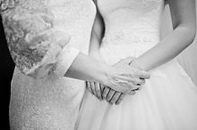 Mom Hand Hold Her Daughter Bride On Wedding Day. Black And White Photo.jpg