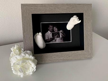 empreintes dans cadre avec photo
