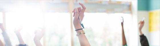 Teenage Students Raising Hands_edited.jp