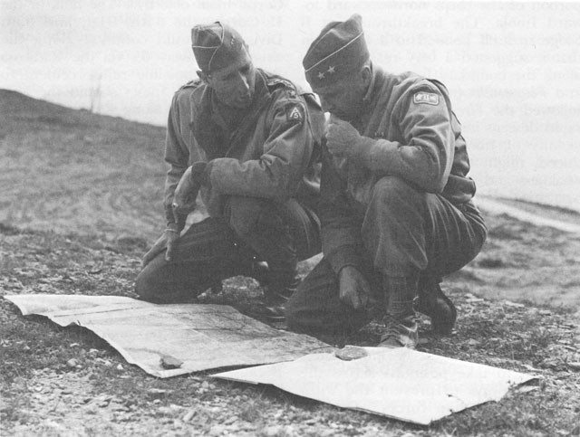Two generals studying a map during World War Two