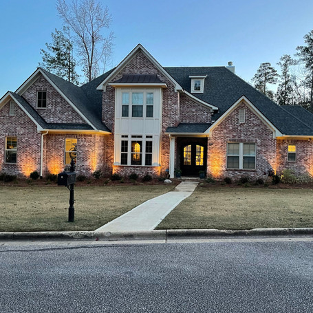 Customed front lights to accent the house's features.
