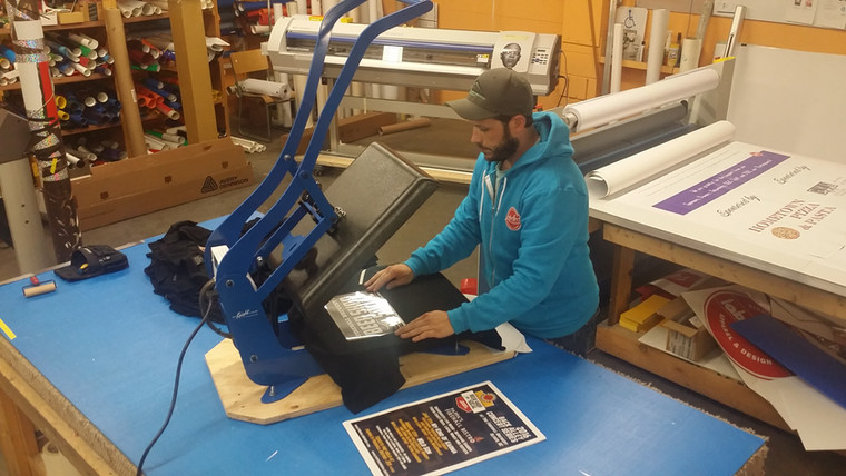 Jeremy Knechtel of Labelled Signs & Printing, printing custom shirts for our campaign rewards.