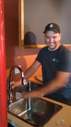 Craig Johnson of Kobau Plumbing, helping us get the waterworks workin'!