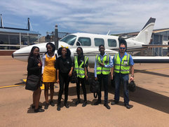 All looking official in front of the SAO aircraft we just flew in