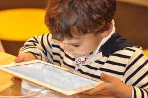 child reading from iPad