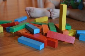toddler with wooden blocks