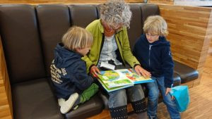 grandmother reading to her grand kids