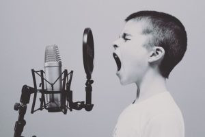 kid screaming into microphone