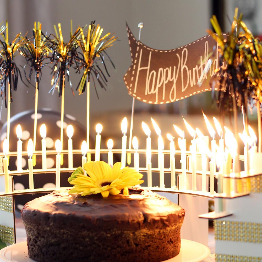Mini pom-poms decorations on candle holder