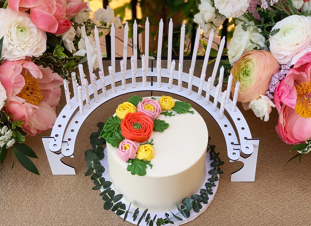 Celebration Stadium candle holder pictured with Sweet Treets top selling cake