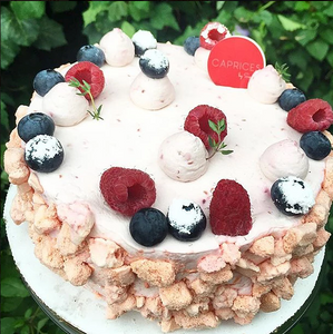 Beautiful birthday cake with fresh, organic berries from Caprices by Sophie