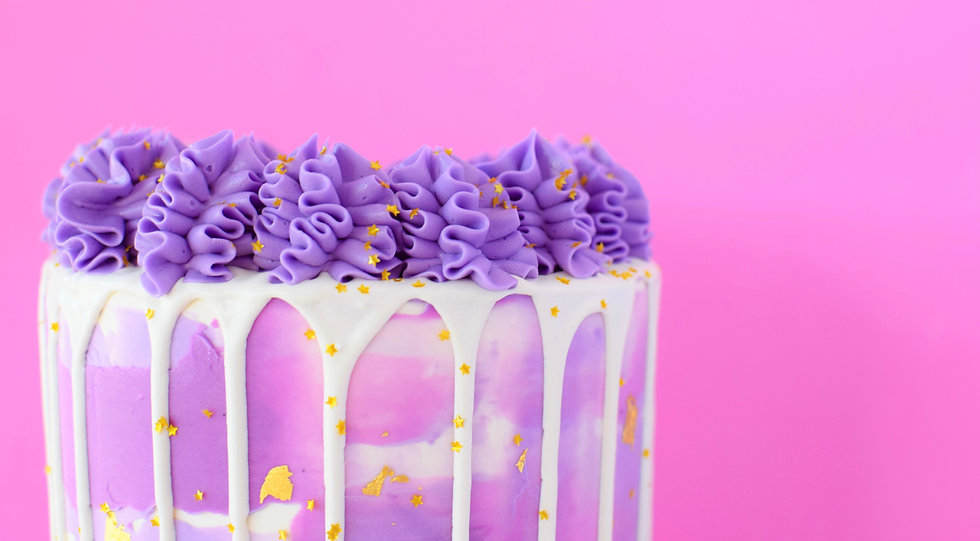 Purple and pink drip cake on pink background
