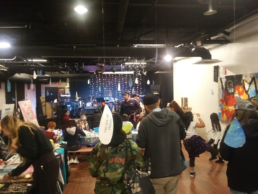 A crowd gathering around the artists and vendors at Sacred Waters Pop-Up Market at Warehouse 508