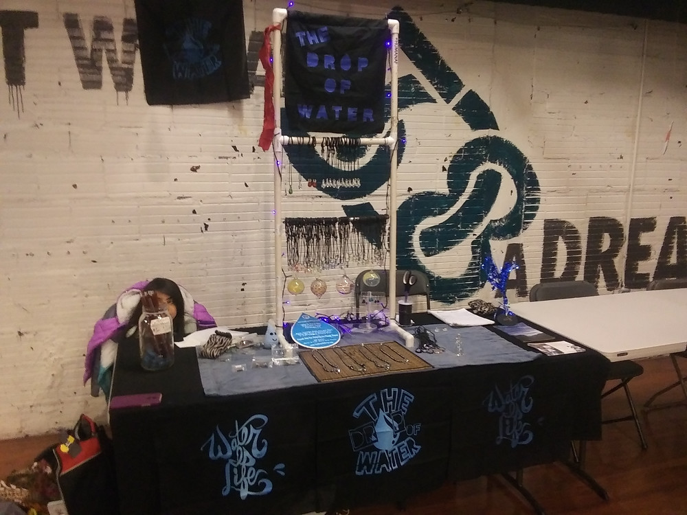 The Drop Of Water booth set up at at Sacred Waters Pop-Up Market at Warehouse 508