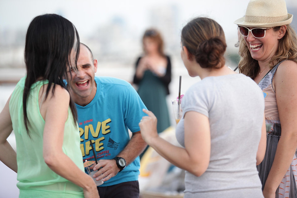 people smiling and Mingling