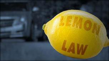 lemon in foreground with the words Lemon Law printed on it
