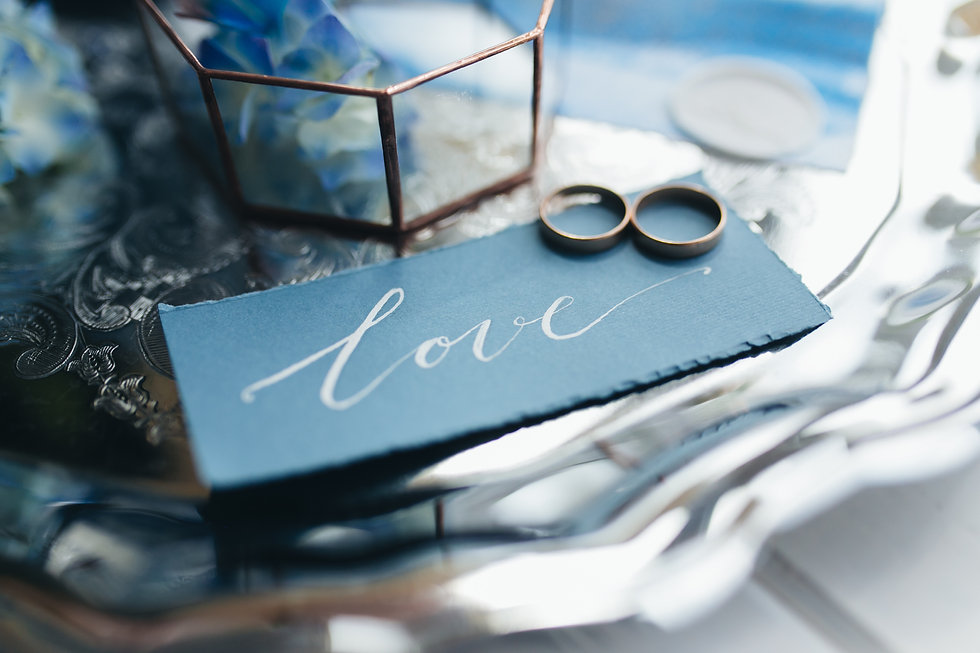 wedding-rings-at-wedding-invitation-with-decoratio-L7UM4YV.jpg