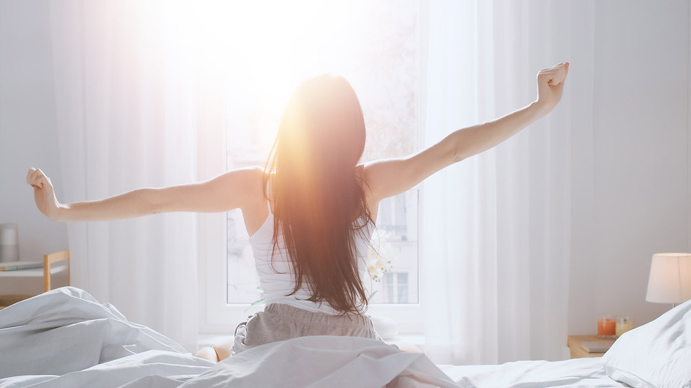Women waking up to a beautiful morning. Orchestrate a perfect morning routine with Wozart.