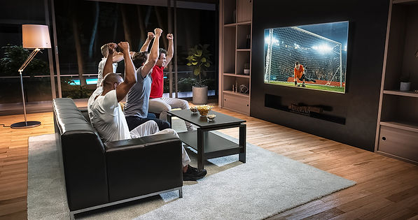 Friends watching a game of football. Set the perfect n'chill feeling with a push of a button.