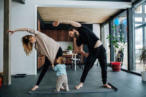 Family excercising in the morning. With a click on Wozart Scene Controller kickstart your morning.