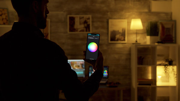 Man controlling light colors using Wozart. Fill the space to your mood.
