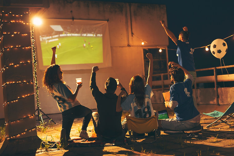 Friends watching football on game night