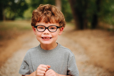 cute boy with curly hair and glasses