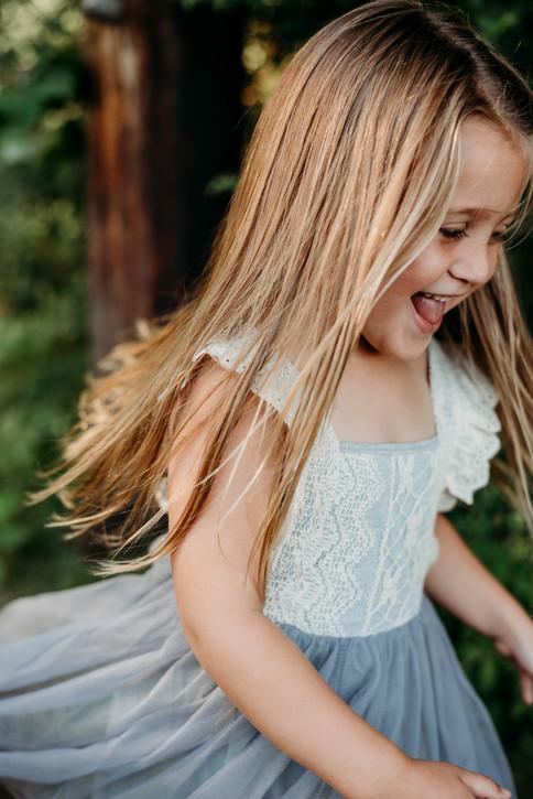 girl twirling in dress