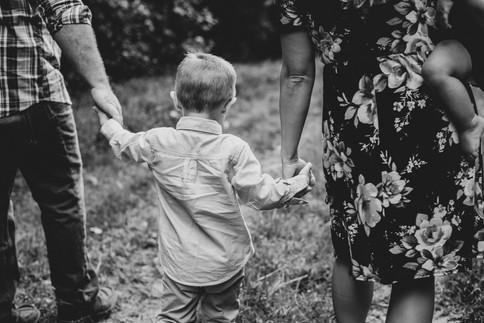 family portrait holding hands
