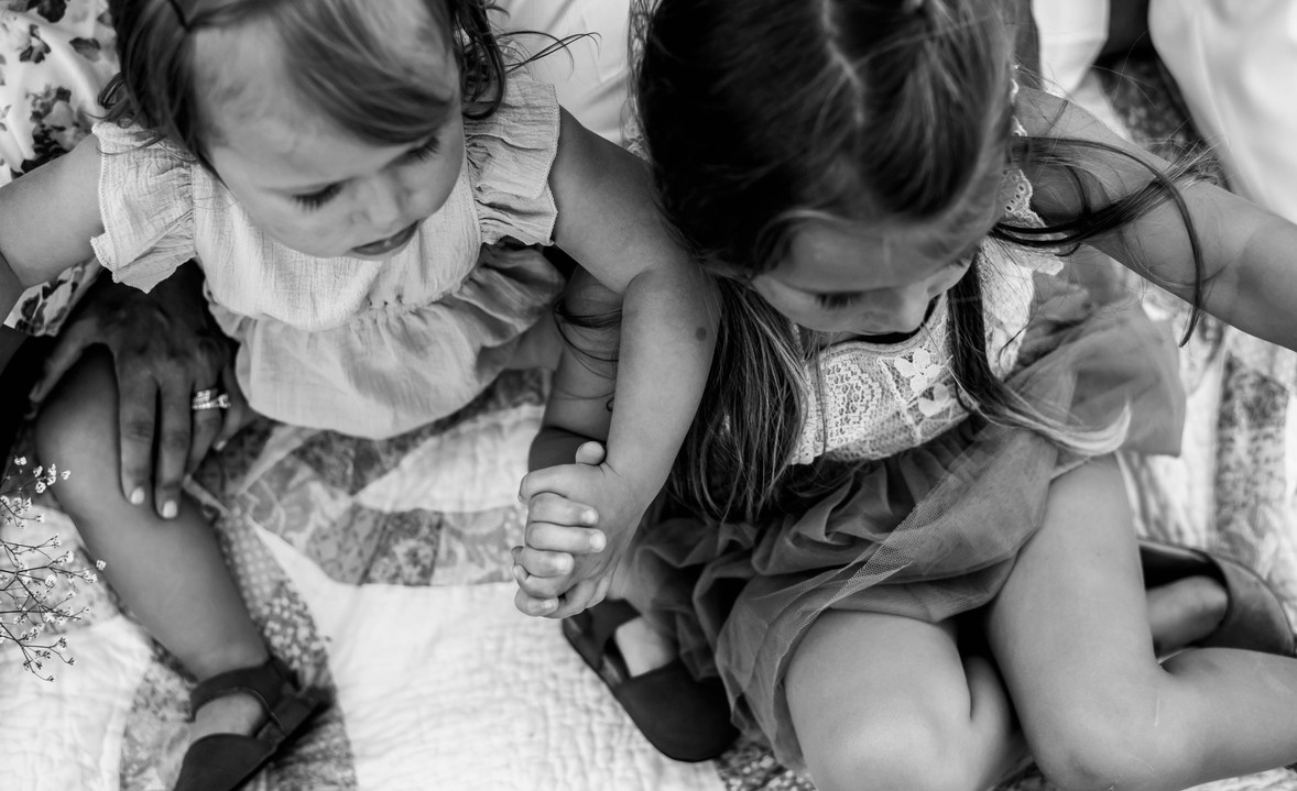 sisters holding hands