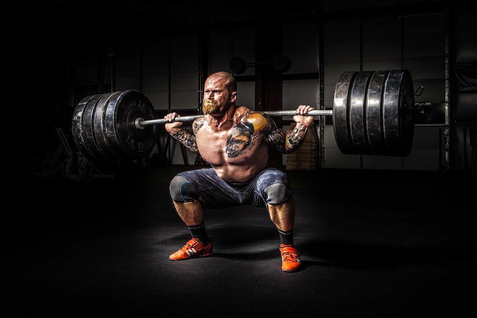 Guy squatting heavy weight