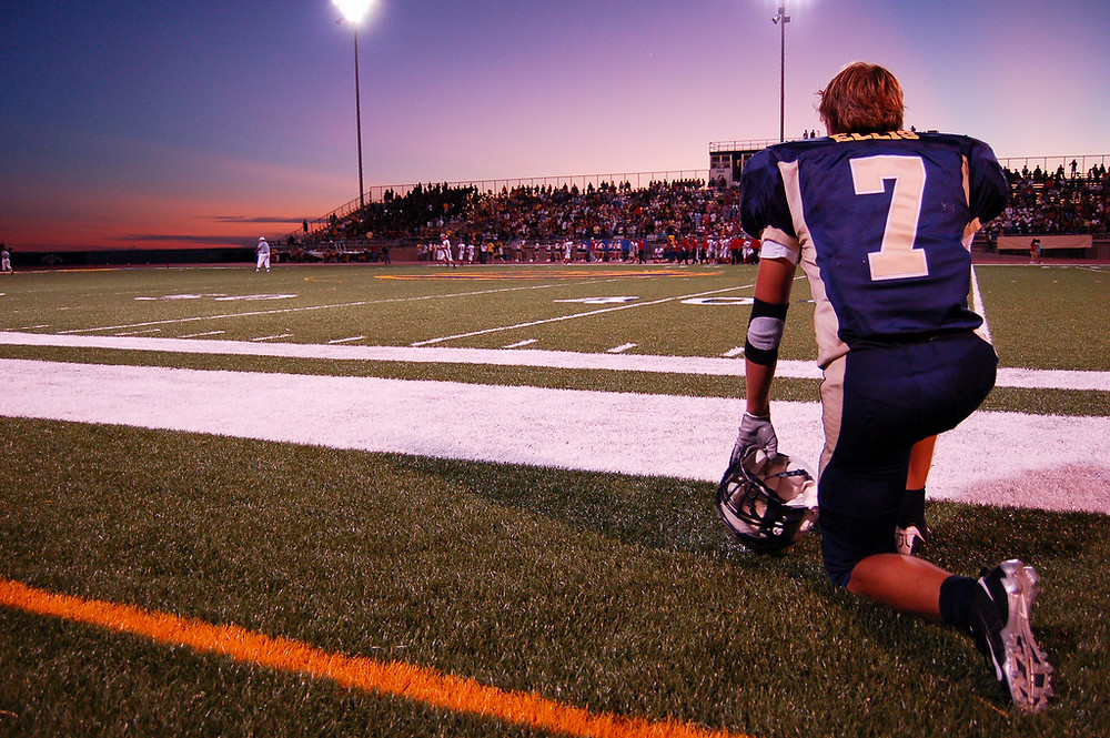 Football player kneeling