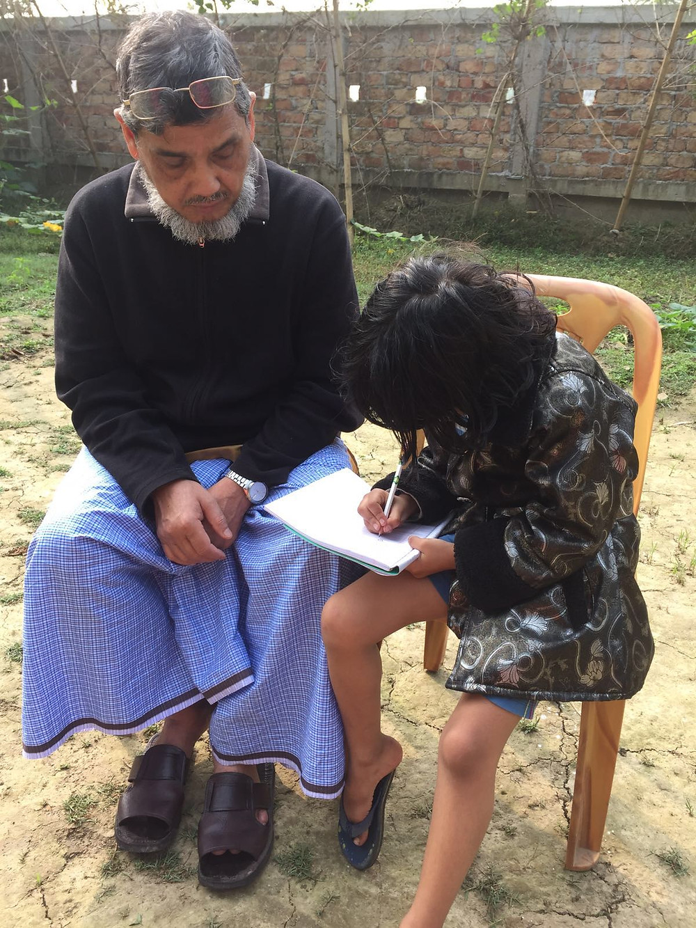 Abbu teaching his latest protege in Bangladesh during his recent visit.