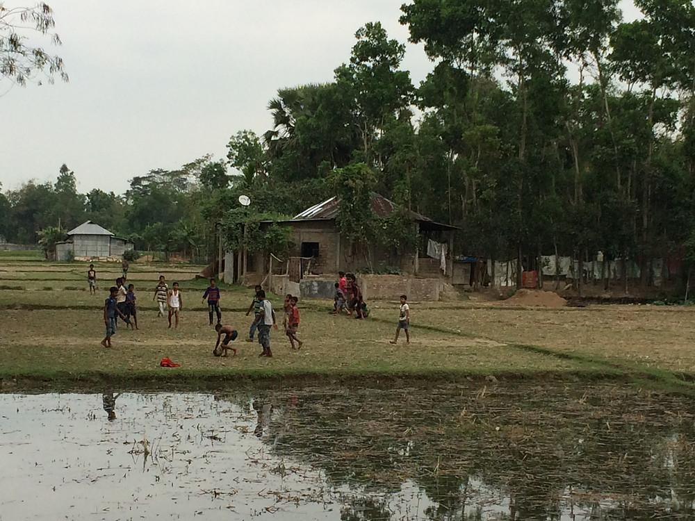 Village children playing football