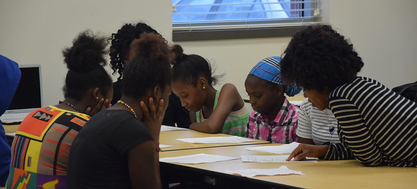 photo of genesis youth foundation children studying